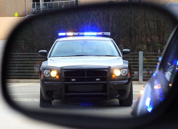 Police car in side mirror